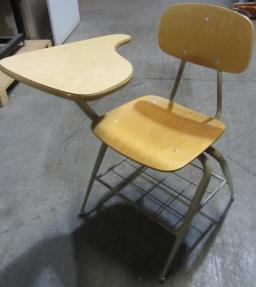 A photo of a metal classroom chair with tiny desk attached at the armrest.